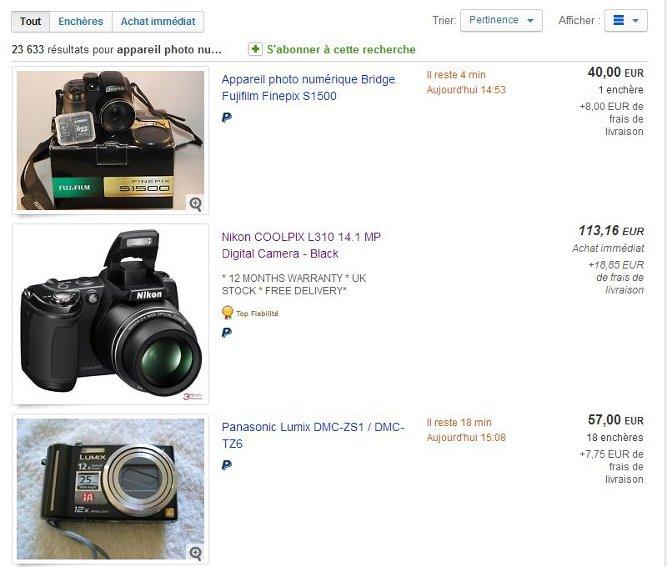 """Si vous cherchez par exemple """"appareil photo numérique"""" dans la barre de recherche eBay, un certain nombre de produits apparaîtront dans les résultats de recherche avec pour chaque fiche produit : l'image, le nom du produit et son prix."""